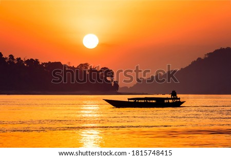 Sunset lake boat silhouette view. Sunset lake boat silhouette. Sunset boat #1815748415