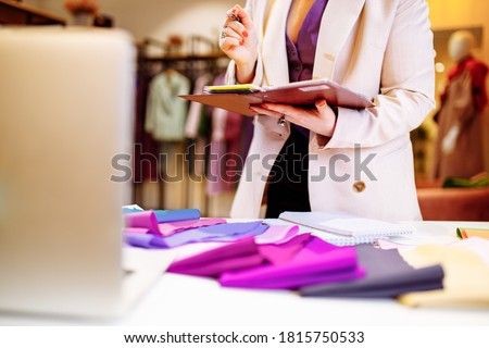 the stylist conducts a color type procedure for a woman,personal consultation about color in clothing Royalty-Free Stock Photo #1815750533