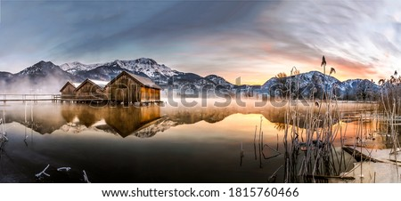 Winter snow mountain lake house panorama in morning time. Sunrise mountain lake panorama. Lake in mountains panoramic view. Mountain lake sunrise landscape #1815760466