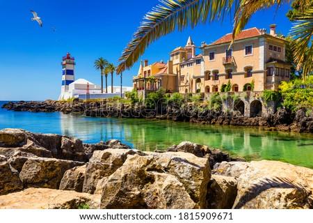 Santa Marta lighthouse and Municipal museum, Cascais, Lisbon, Portugal. Lighthouse Museum of Santa Marta in Cascais Portugal, as seen from Santa Marta Beach on a beautiful day. Cascais, Portugal. #1815909671
