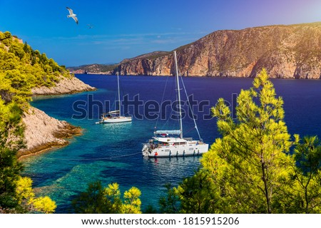 Aerial view of anchored sailing yacht in emerald sea. Aerial view of a boat. Outdoor water sports, yachting. Aerial view of anchoring yacht in open water. Ocean and sea travel and transportation #1815915206