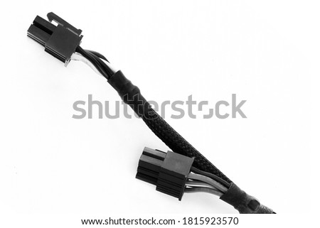 black wires on white isolated background close-up for power supply computer peripherals