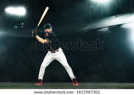 Porfessional baseball player with bat on grand arena. Ballplayer on stadium. Royalty-Free Stock Photo #1815987302