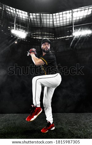 Porfessional baseball player with ball on grand arena. Ballplayer on stadium in action. Royalty-Free Stock Photo #1815987305