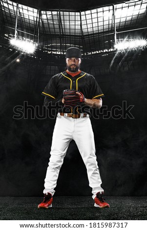 Porfessional baseball player on grand arena. Ballplayer on stadium in action. Royalty-Free Stock Photo #1815987317