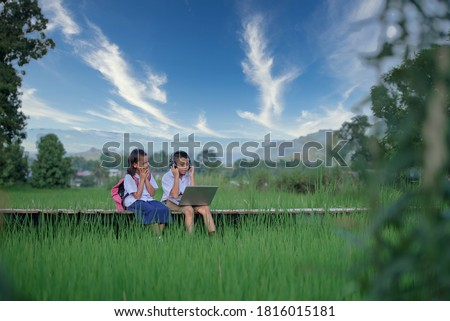 Elementary school children Asians living in rural areas and rural schools of Thailand Primary school children are studying online using their laptop to view materials. Royalty-Free Stock Photo #1816015181