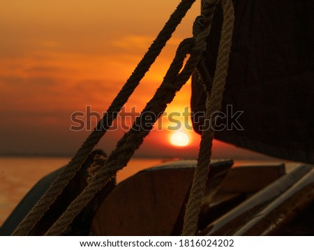 This is a picture taken at sunset on the Gooimeer in the Netherlands. The photo shows the ropes with which the sails are operated. The ship is an old Dutch fishing vessel called the Botter.