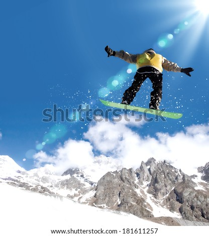 Snowboarder making jump high in clear sky #181611257