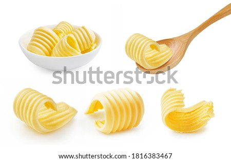 Set of butter curl on wooden spoon. Butter roll in white bowl isolated on white. #1816383467