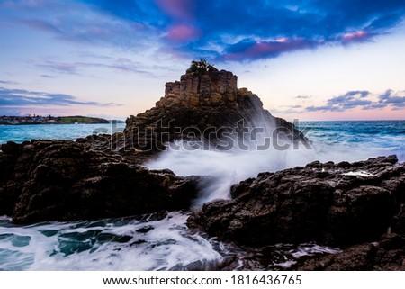 Strong wave crashing rocks along the coast line in Australia Royalty-Free Stock Photo #1816436765