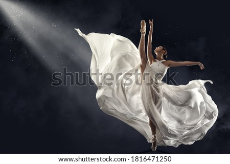 Ballerina Jumping in White Silk Dress, Modern Ballet Dancer in Pointe Shoes, Fluttering Waving Cloth, Gray Background Royalty-Free Stock Photo #1816471250