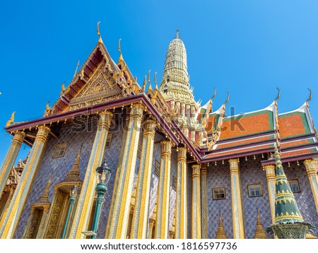 The Royal Pantheon, unique beautiful building in The Temple of Emerald Buddha, landmark of Bangkok, Thailand, under summer blue sky