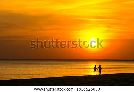 Sunset beach couple in love scene. Sunset sea horizon landscape. Sea sunset horizon view. Couple on sunset beach #1816626050