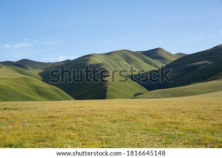 High altitude mountains with grassland landscape Royalty-Free Stock Photo #1816645148