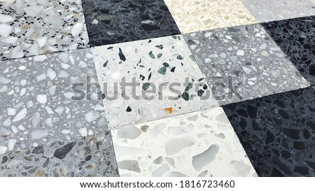 various pattern and color of terrazo stone samples ,classic italian floor composed of natural stone, granite, quartz, marble, glass and concrete (focused at center of picture).