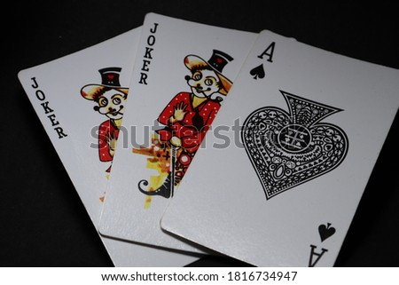 joker playing  card decoration on black background.