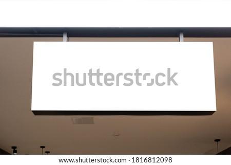Mock up. Horizontal white empty signage on store shop front inside shopping mall