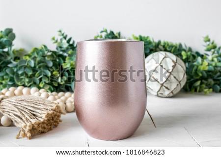 Blank rose gold insulated sublimation wine tumbler, farmhouse style background, drinkware mockup