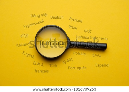 International language translation search concept with magnifying glass.