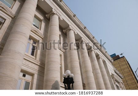 Pillars of Courthouse. Justice. Law & Order. Supreme court look. Columns in the style of classical architecture. Classic style. Legal system. Court hearing. Legal. Lawsuit. Court proceeding.  #1816937288