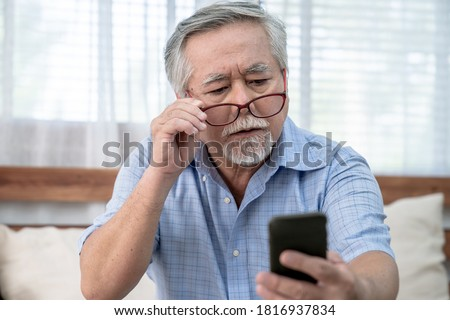 Asian elderly man who has eye pain and poor vision, Long sighted, Glaucoma. Royalty-Free Stock Photo #1816937834