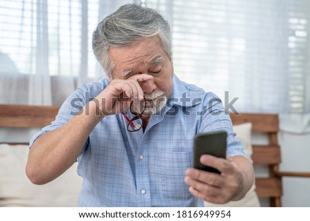 Asian elderly man who has eye pain and poor vision, Long sighted, Glaucoma. Royalty-Free Stock Photo #1816949954