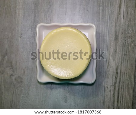 Top view of a small plain cheesecake.