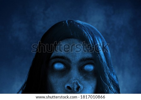 Scary ghost on dark background Royalty-Free Stock Photo #1817010866