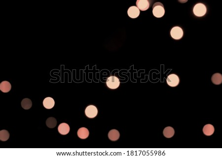 Beautiful Pink and Rose gold Bokeh glitter on Black Background. Party, Romance, Holiday.