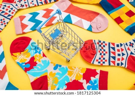 Shopping cart and floral socks, female dress consumer shopping concept