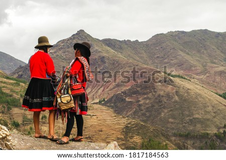 Beautiful picture of Peruvian girls in their traditional dress in the mountains of Peru