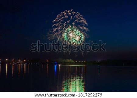 Fireworks. Salute multicolored on the black sky.