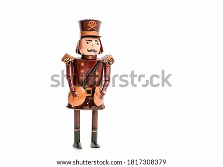 Cute decoration for the Christmas tree. Beautiful figurine of a military musician on a Christmas tree on a white isolated background. Holiday, celebration, NewYear, Noel concept.