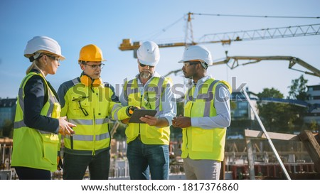 Diverse Team of Specialists Use Tablet Computer on Construction Site. Real Estate Building Project with Civil Engineer, Architect, Business Investor and General Worker Discussing Plan Details. Royalty-Free Stock Photo #1817376860