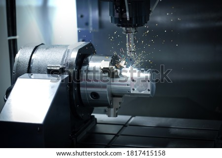 CNC Mechanical and technology industry 4.0. The process of turning with a cutting and milling tool the outer surface detail of the metalworking parts. Royalty-Free Stock Photo #1817415158
