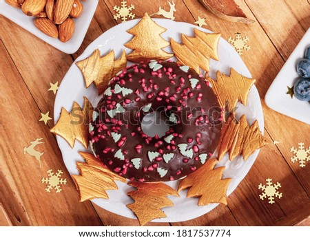 New Year's donut with cookies in the shape of a Christmas tree on a wooden table, top view close-up. #1817537774