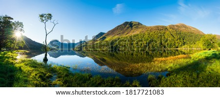 Sunrise panorama of Buttermere lake in the Lake District. England Royalty-Free Stock Photo #1817721083