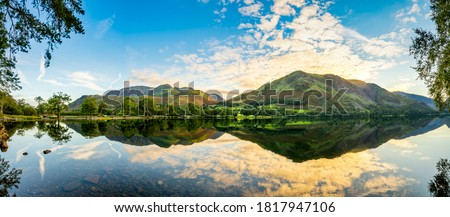 Buttermere lake panorama at sunrise. Lake District. England Royalty-Free Stock Photo #1817947106