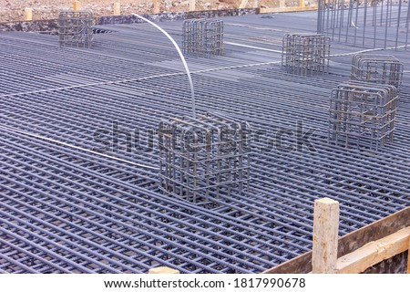 Rebars for reinforced concrete. Rebar, known when massed as reinforcing steel or reinforcement steel. It is a steel bar or mesh of steel wires used as a tension device in reinforced concrete. #1817990678