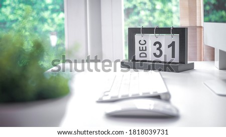 Calendar Concept - December 31st. loose-leaf calendar with the date of December 31 on white working table background. Royalty-Free Stock Photo #1818039731