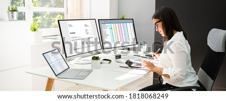 Online Taxes And Invoice Using Computer And Calculator Royalty-Free Stock Photo #1818068249