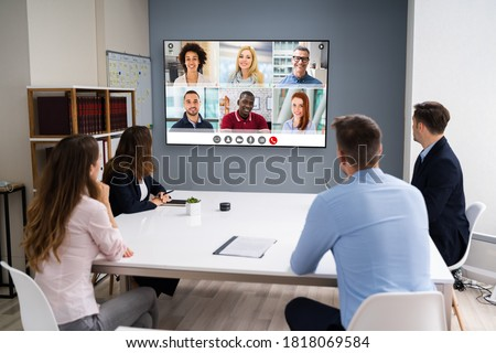 Online Video Conference Social Distancing Webinar Business Meeting Royalty-Free Stock Photo #1818069584