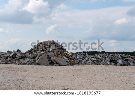 a construction site with gravel floor and a pile of broken rubble Royalty-Free Stock Photo #1818195677