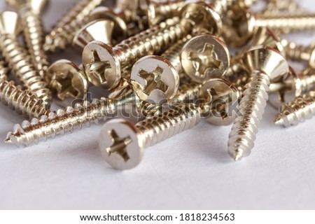 Tapping screws made od steel, metal screw, iron screw. Royalty-Free Stock Photo #1818234563