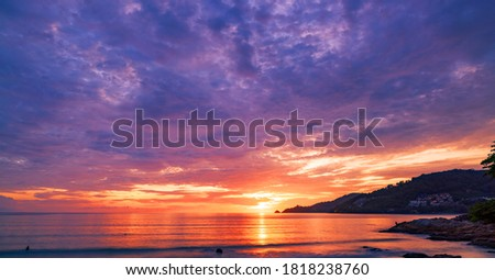 Landscape Long exposure of majestic clouds in the sky sunset or sunrise over sea with reflection in the tropical sea Royalty-Free Stock Photo #1818238760