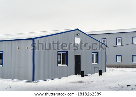 Household and residential buildings of the shift camp. The picture was taken in Russia in winter