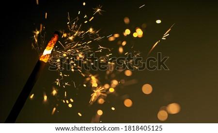 festive burning sparkler macro photo multicolor bokeh #1818405125