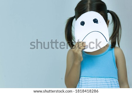 A little girl with a sad face. Drawing of a unhappy frown. Sad people.
