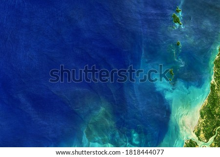 Sea taken from space, detailed Earth surface on global satellite photo. Aerial top view of blue ocean, tropical coastal waters for nature texture background. Elements of this image furnished by NASA. #1818444077