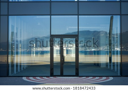 beautiful glass facade of the premises for renting a shop. For designers as an example of outdoor advertising and signage placement. Royalty-Free Stock Photo #1818472433